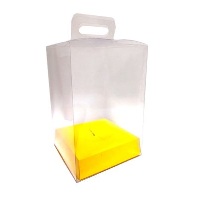 Caja de pvc transparente con asa y base en color amarillo